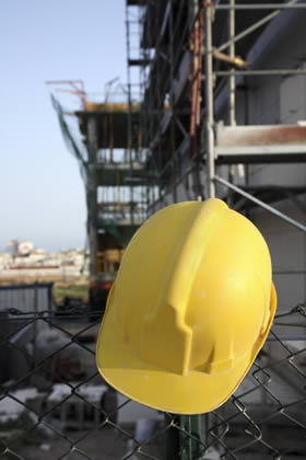 A builders hard hat on a construction site